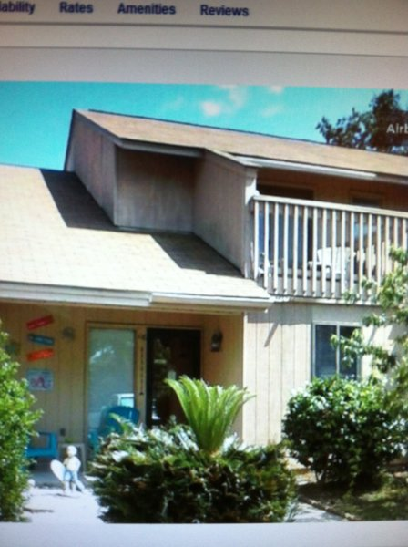 Grandpa Jack's beach house! Just look for the turquoise chairs out front!