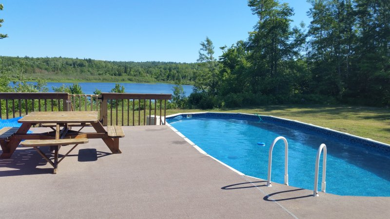 Deck and 4' deep above ground heated pool with a view overlooking Furnace Lake
