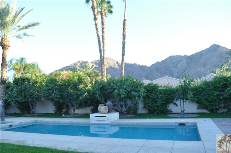 Very private, sunny, south facing back yard with large, mosaic tile,  salt water pool and spa.