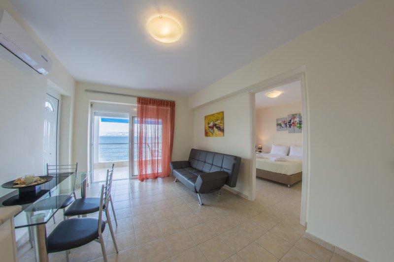 Een appartement met uitzicht op zee Slaapkamer