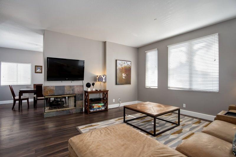 Large modern living room with big flat screen HD TV