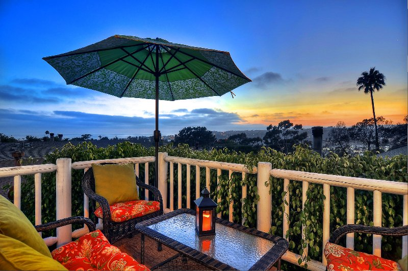 Enjoy the view from the outdoor patio next to upstairs living room
