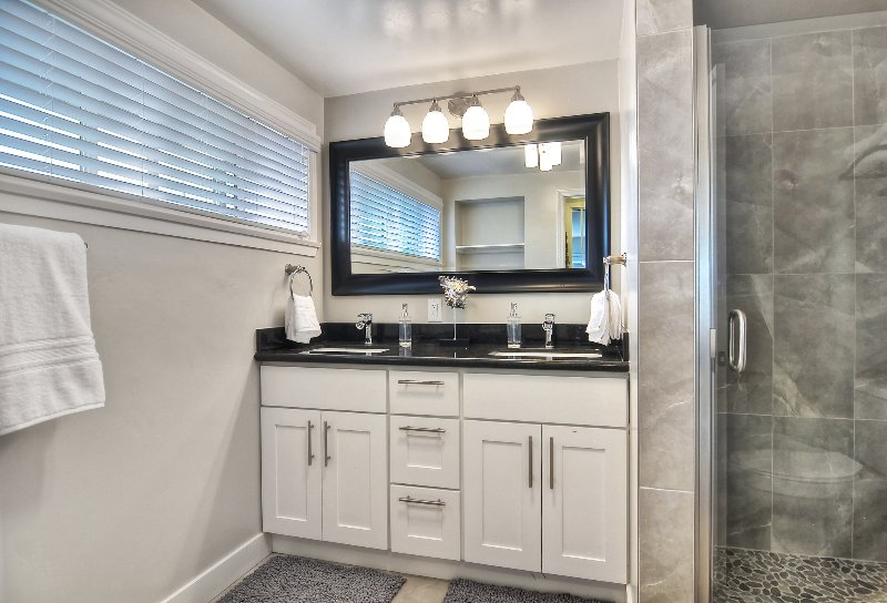 Bathroom #2 has double sinks and shower