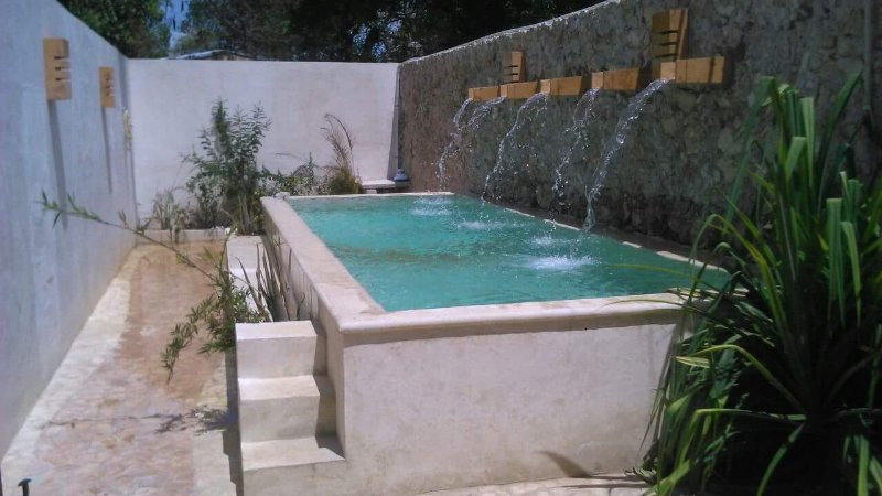 Casa Metzli's refreshing pool and its waterfalls