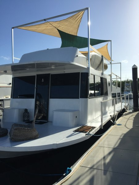 This is the most cleanest comfortable house boat in the keys! Triple sunshade upper deck