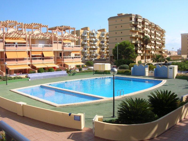 COMPLEJO EL ARENAL REF A128 CON PISCINA, vacation rental in Xeraco