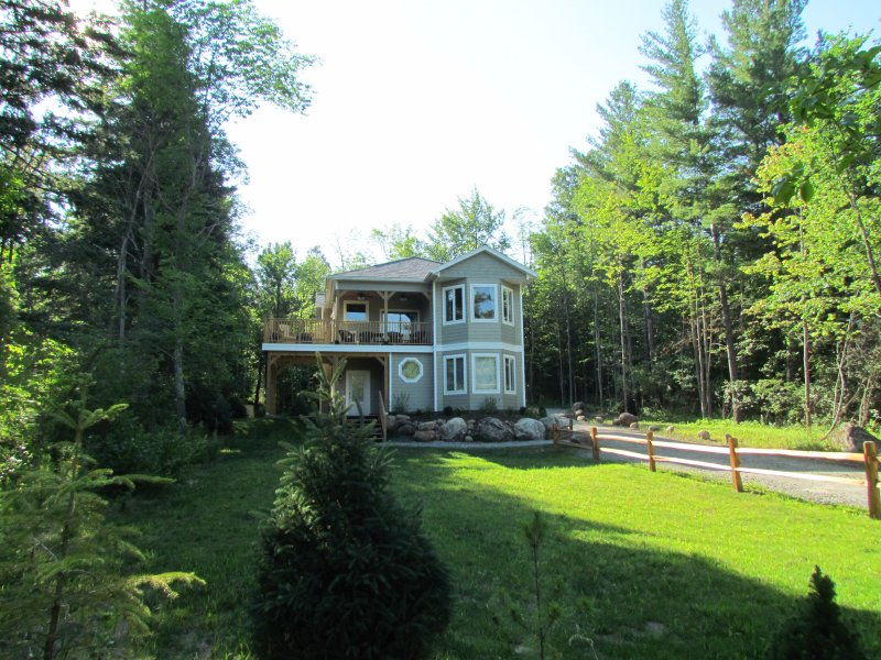 Main view of White Spruce Cottage in early summer.