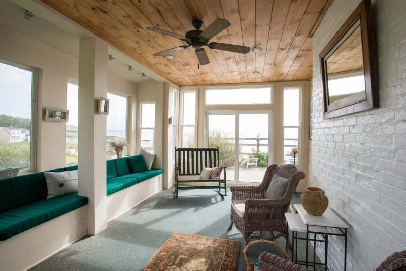 Sunrise sunroom with views from all windows