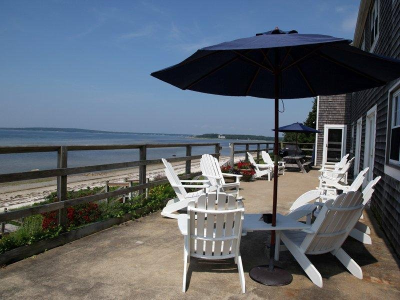 Wonderful 80 foot deck with adirondack chairs