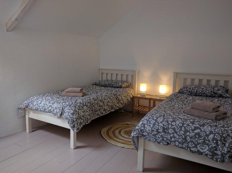 Twin bedroom 4. Vaulted ceiling & exposed beams.