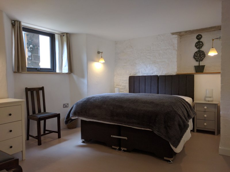 Level-access double bedroom 5.  Can also be made up as a twin room.