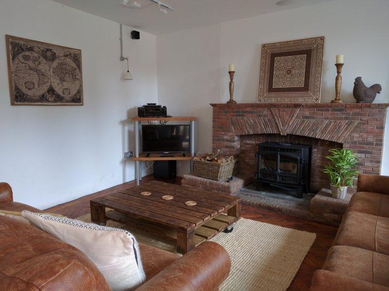 Leather sofa's, woodburner...
