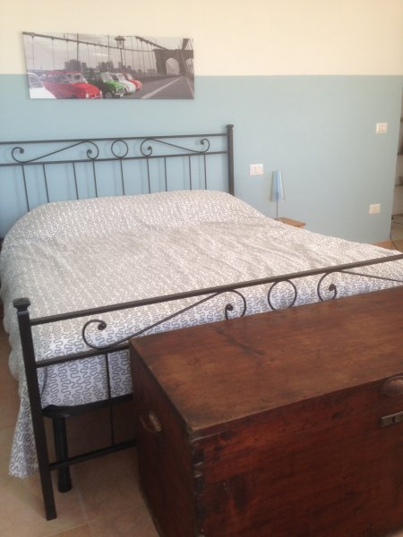 1 of the many beds in casa cologna