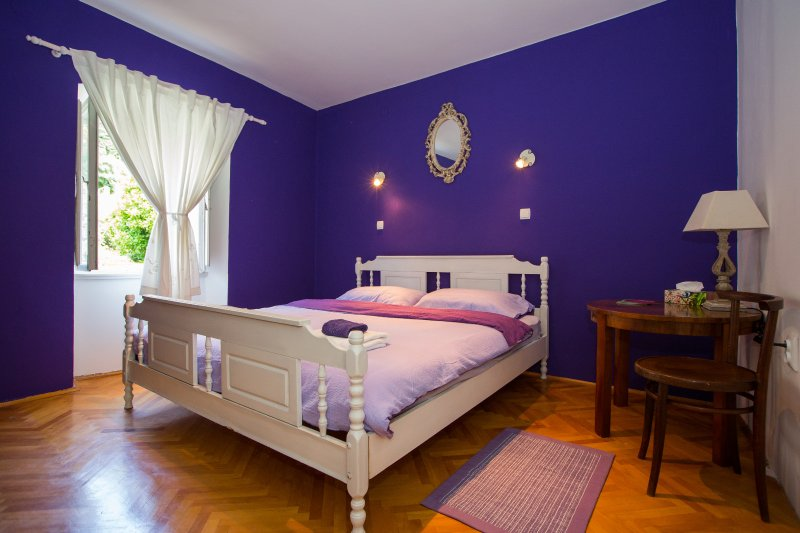 Master bedroom with a king size bed and street view towards Mount Srd