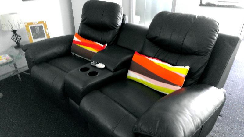 Motorized reclining leather theater chairs with lumbar pillows