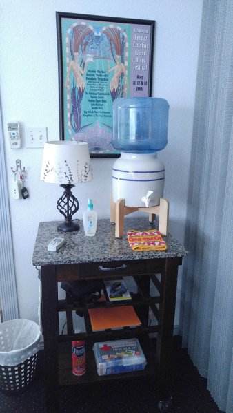 Entrance table with bottled water and assorted types of bug sprays