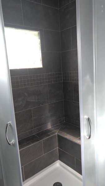 bench seating in the Neo shower and a window for plenty of light!