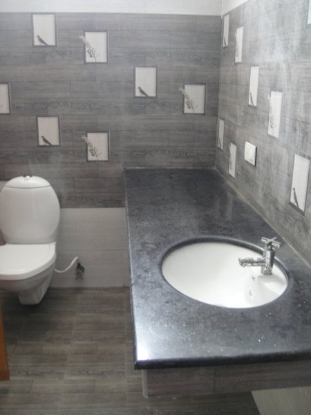 Modern attached bathroom with 24 hours water supply equipped with geyser for hot water.