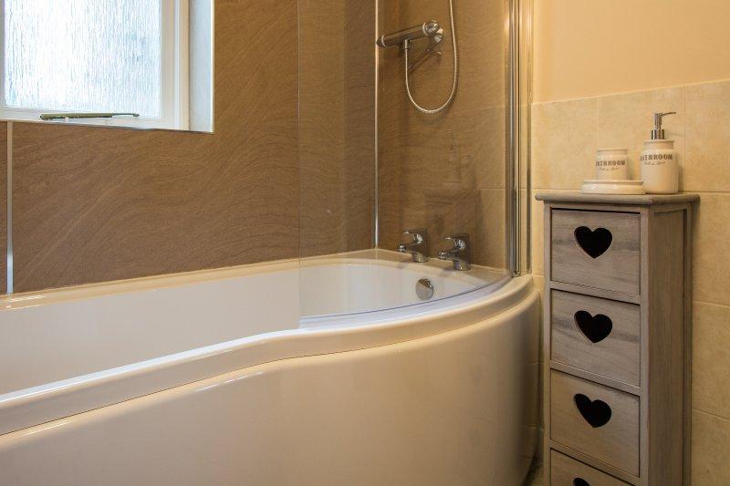 Bathroom with shower over bath.
