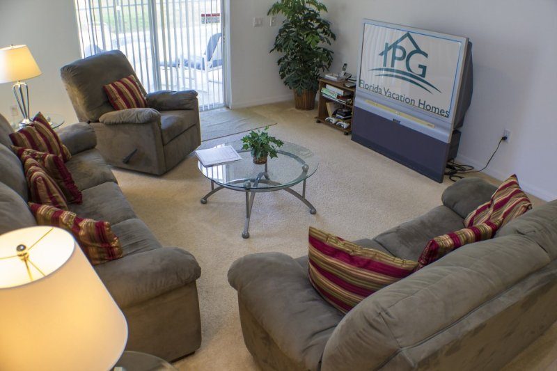 The Family Room,With Patio Doors to the Pool and 50' TV.