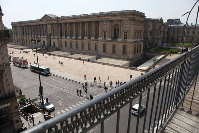 Breathtaking views of the magnificent Louvre from the long balcony of our beautiful apartment