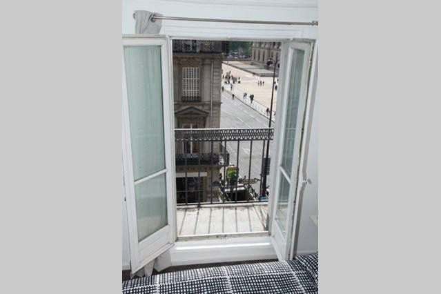 Room view on the Louvre Museum and from its long balcony, the Rue de Rivoli.