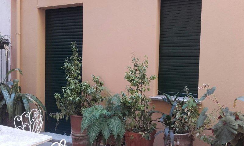 fenêtre Bathroom's au patio et l'accès de la chambre 2 au patio