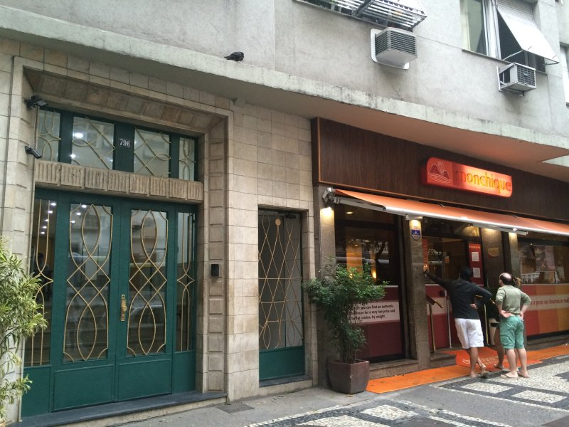 entrance of the building, the restaurant next door