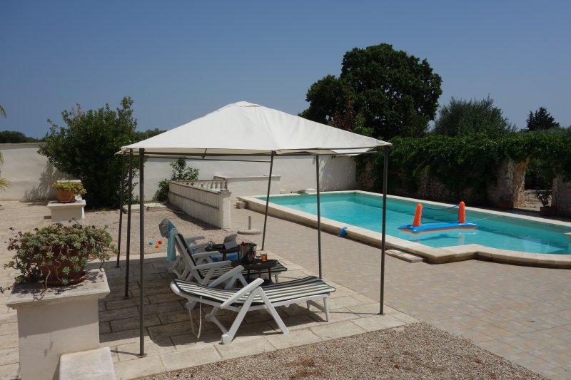 Shaded poolside with boules area