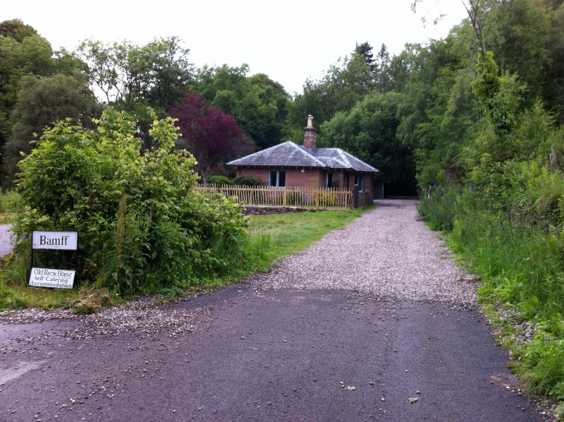 The Gate Lodge is a pretty cottage at the entrance to Bamff, as viewed approaching from Alyth.
