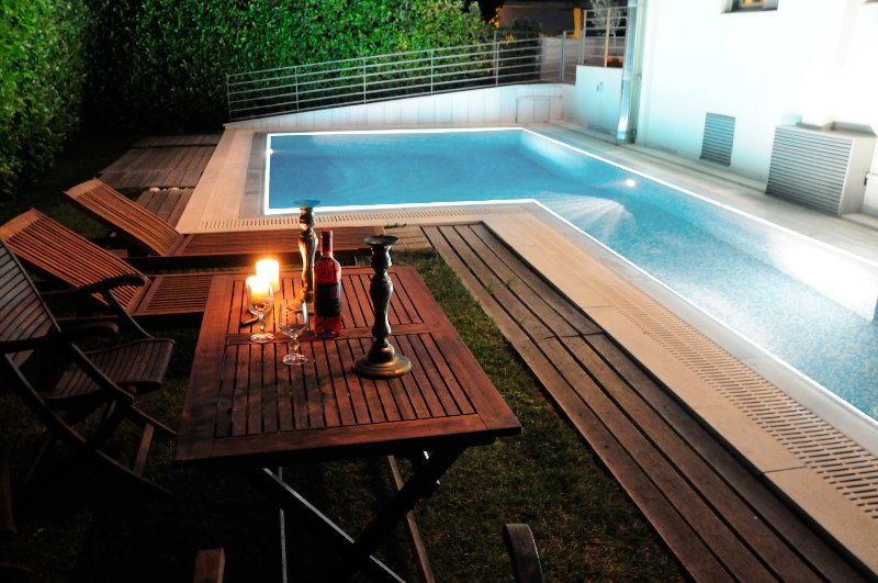 The shared swimming pool at night