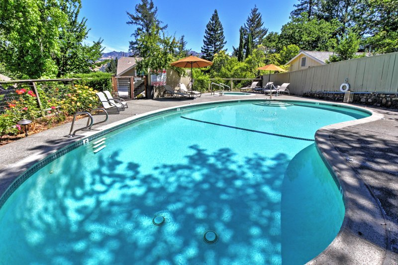 The picturesque exterior space features a private pool and hot tub.