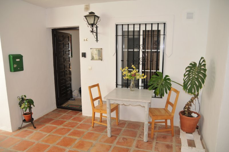 Entrance to the apartment, with small dining table