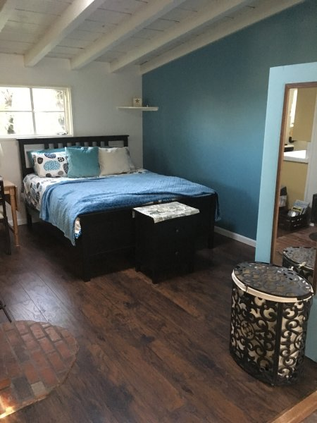 The guest house has a big queen bed, closet and huge screen TV.