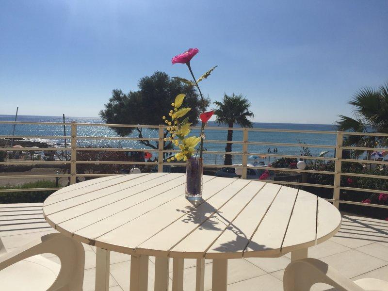The spacious veranda overlooking the sea.