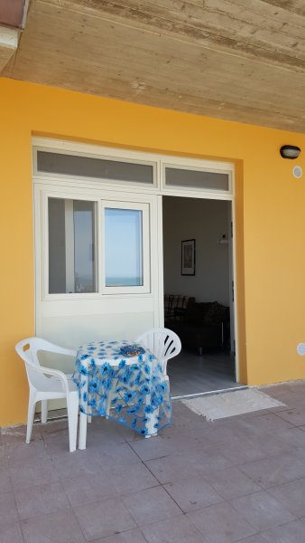 Entrance apartment with a small table for breakfast, drinks