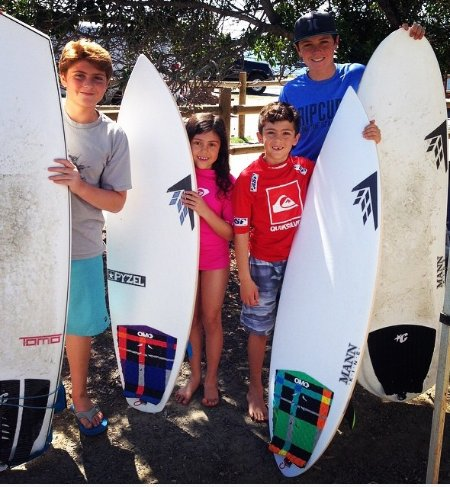 Our 4 kids going to catch some waves