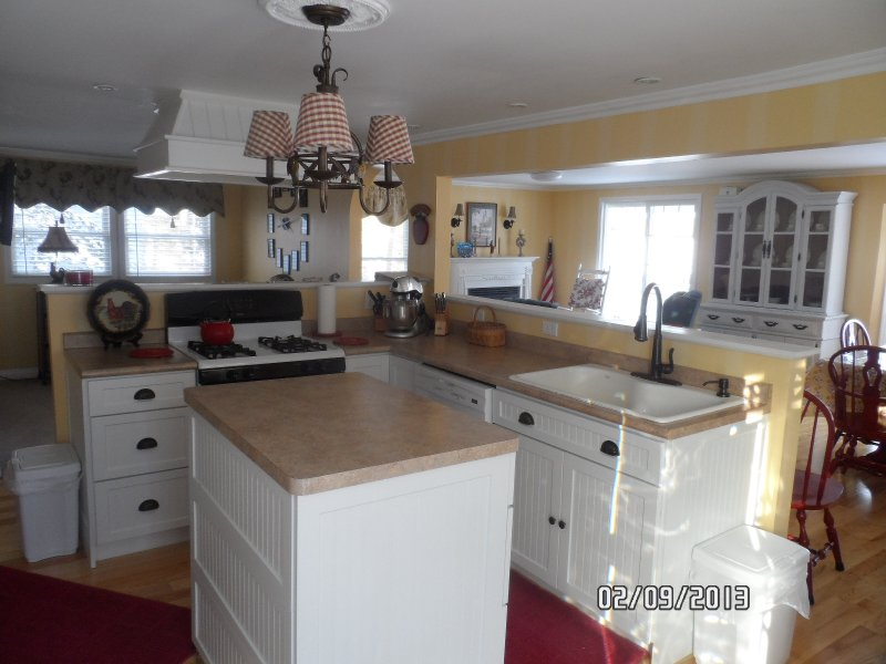 Full Kitchen contains 2 ovens, refrigerator with ice/water dispenser, dishwasher & microwave.