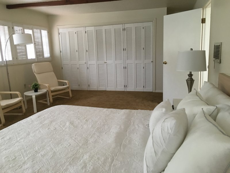 The master bedroom has a new king bed, new bedding and  sitting area, with a spacious redwood closet