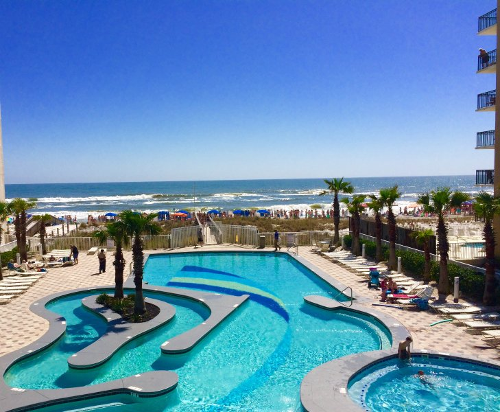 lazy river pool and hot tub over looking beach