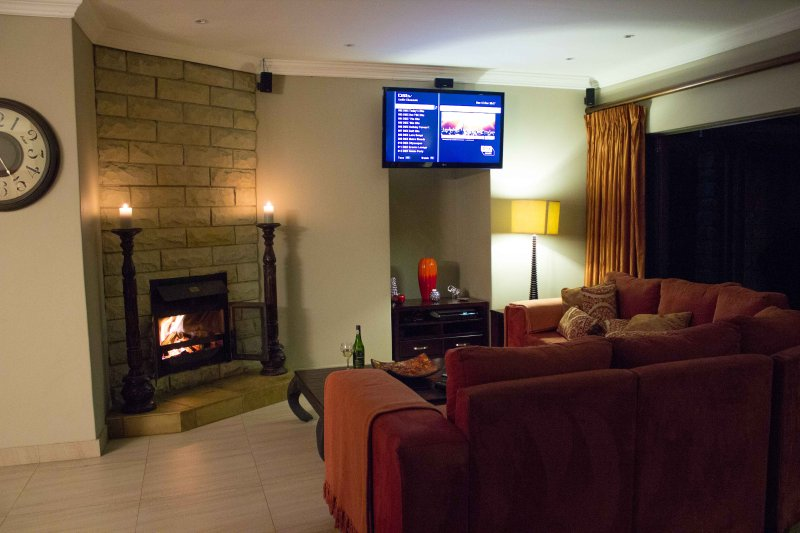 Main Lounge with TV and fireplace