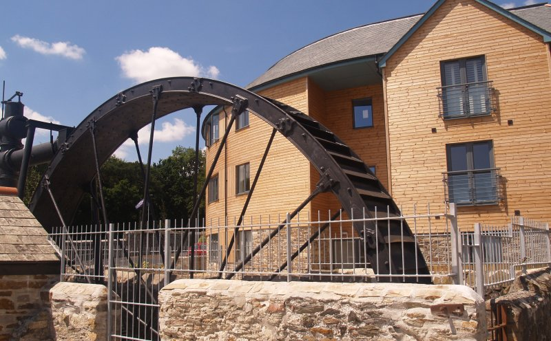 The restored waterwheel and outside the apartments