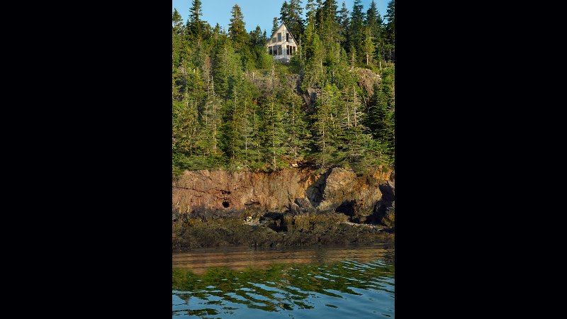 Enjoy a spectacular view of Howards Cove, distant lighthouses, lobster boats and buoys.