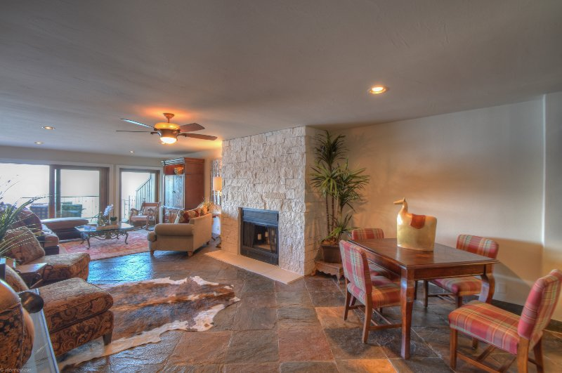Stone floors, oriental carpet and wood burning limestone fireplace spells Hill Country elegance.
