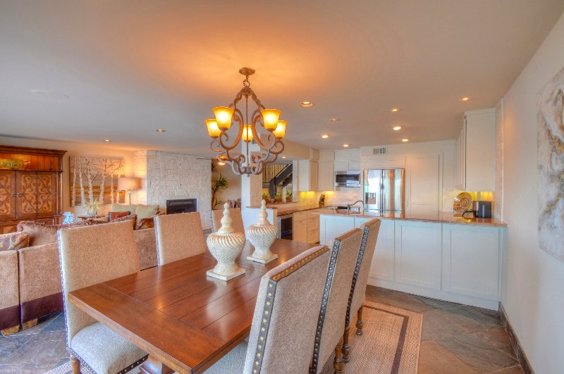 Gourmet kitchen with new dining room table and chairs invite