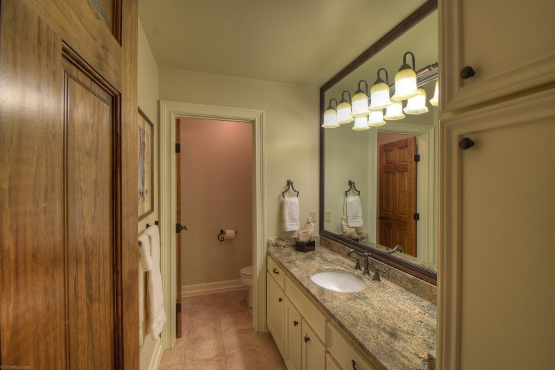 Twin bedroom bath with granite tops and lovely stone shower