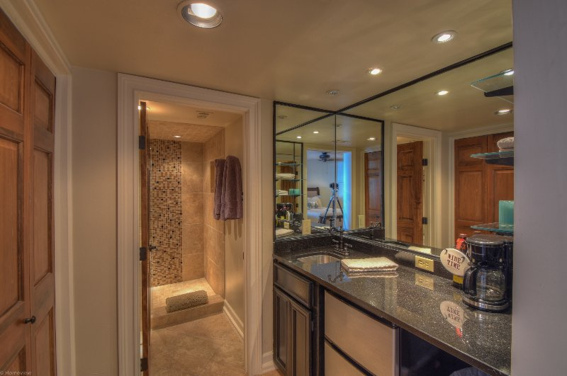 A wet bar, bathroom, washer/dryer, & small refrigerator/freezer allow for every guest comfort needed