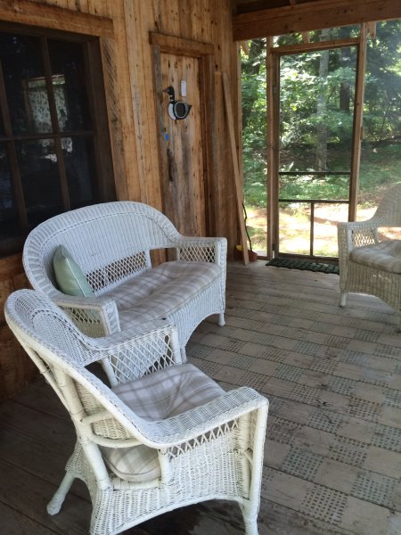Front porch with furniture.