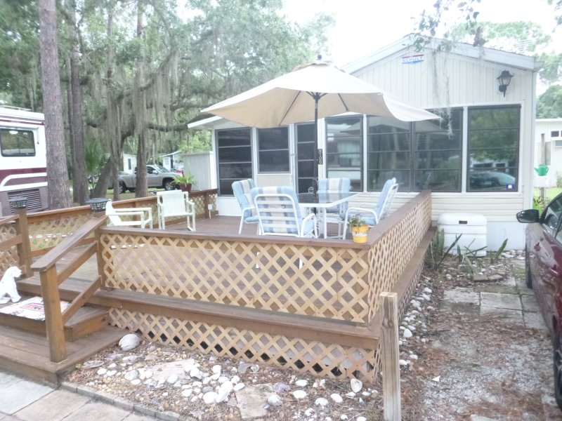 Gorgeous deck in the front, perfect for entertaining, or just relaxing in the shade from 5pm on.