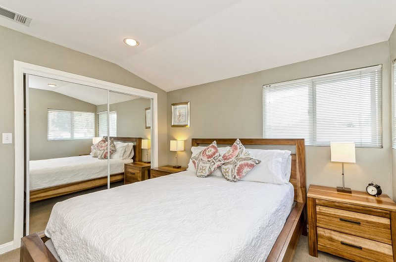 Mahogany bedroom set: Queen-sized bed with a pillowtop mattress. This bedroom also has 2 nightstands